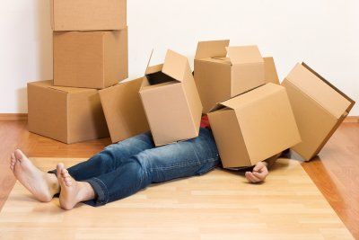 Piled Boxes on Woman